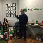 SnipSnap CEO Ted Mann toasting the team